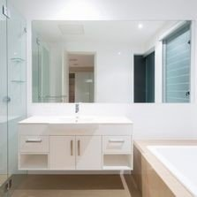 Bathroom with bath, vanity, mirror & shower | Bay 2 Bay Group